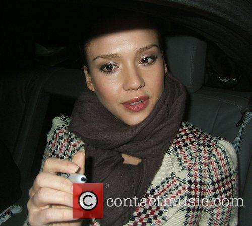 Signing autographs from her car, whilst leaving a...