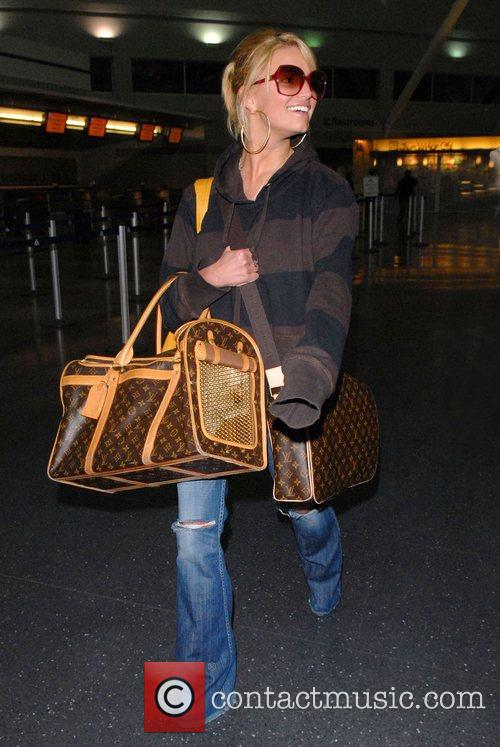 Jessica Simpson arriving at New York's JFK Airport...