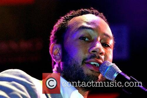 John Legend performs at a private concert during...