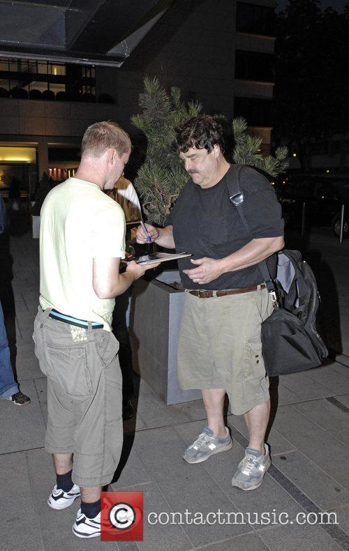 John Goodman arriving back at his hotel after...