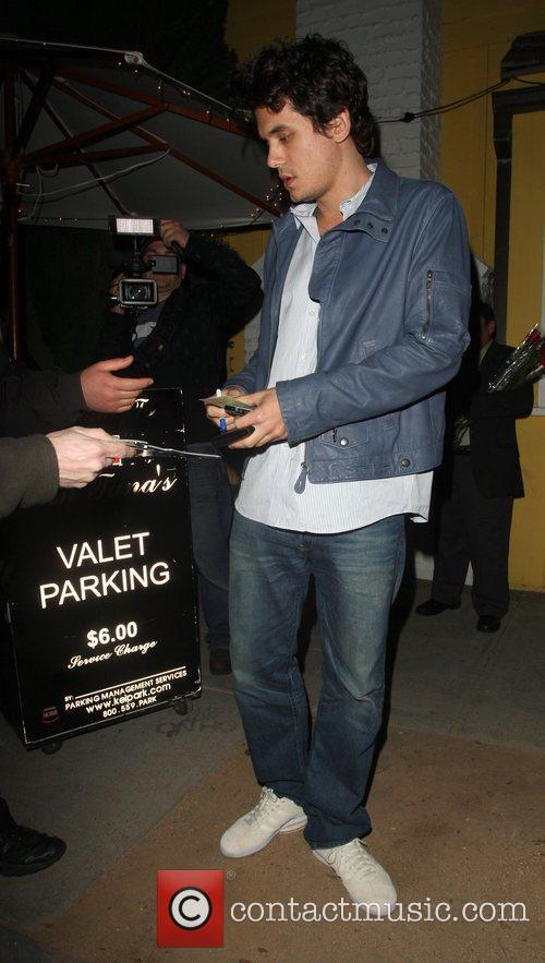 John Mayer leaving Dan Tannas Restaurant. An autograph...