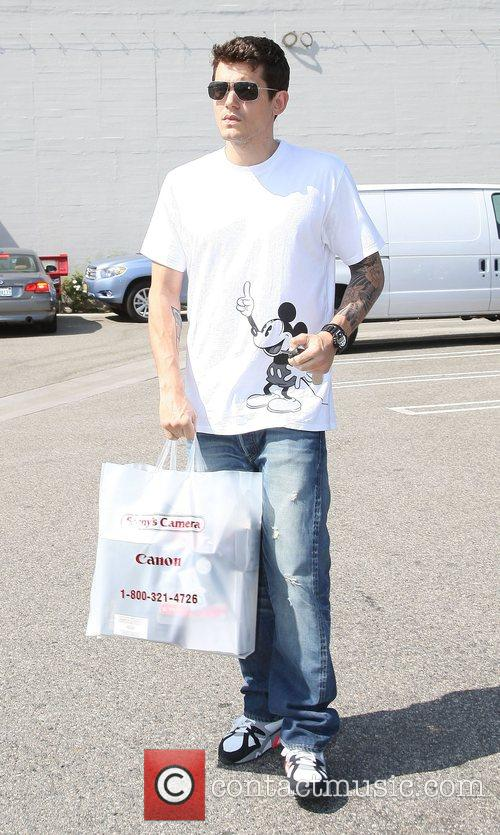 John Mayer wearing a Mickey Mouse print shirt,...