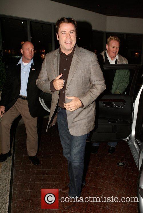 John Travolta arriving at a London hotel earlier...