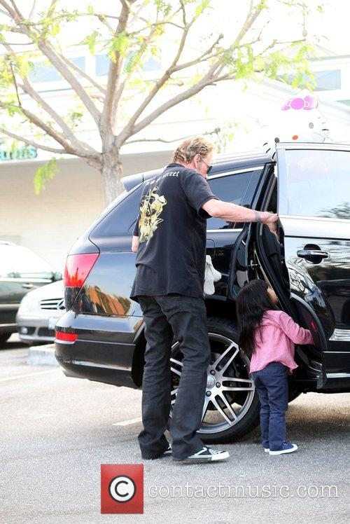 Johnny Hallyday and his daughter leaving a shopping...