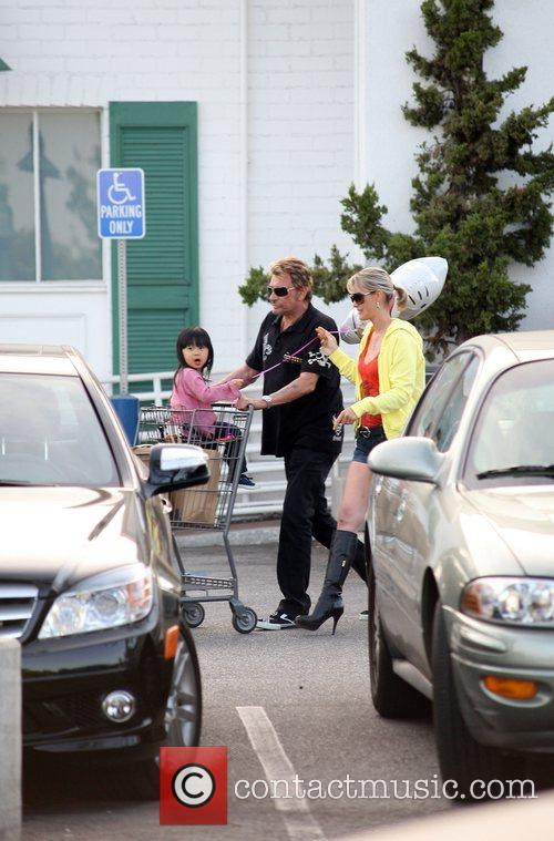 Johnny Hallyday and his family leaving a shopping...