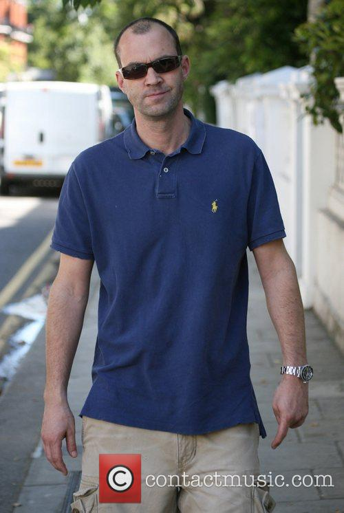 Johnny Vaughan takes a stroll with his sunglasses...