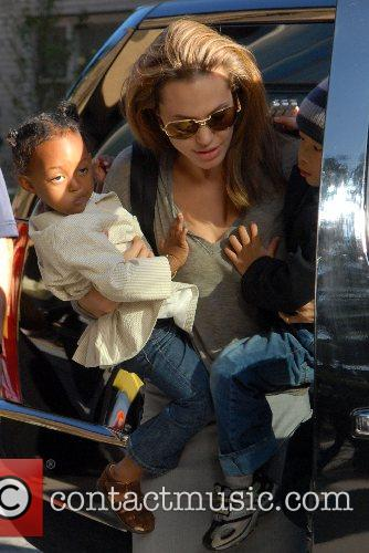 Zahara, Angelina Jolie, and Pax arrive at the...