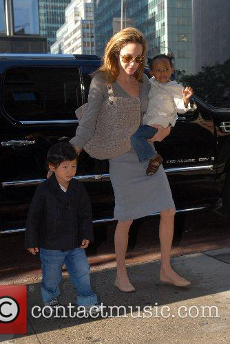 Pax, Angelina Jolie, and Zahara  arrive at...