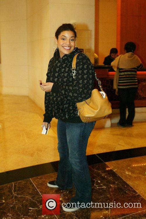 Arrives at the Mandarin Oriental Hotel