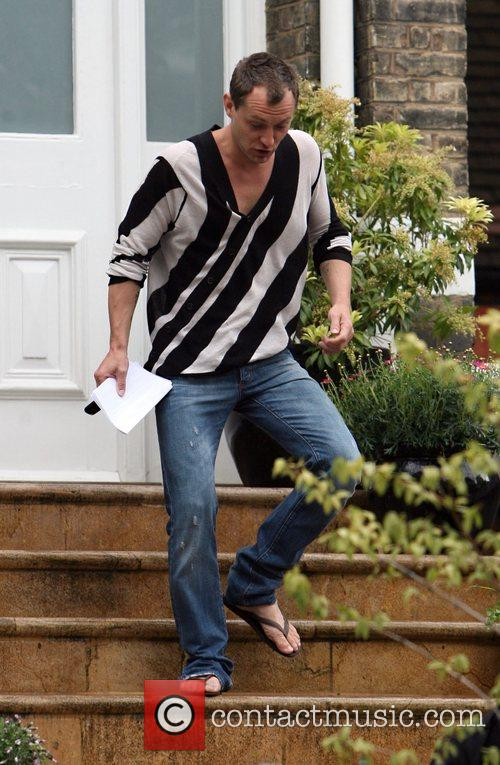 Jude Law seen leaving the home of his...