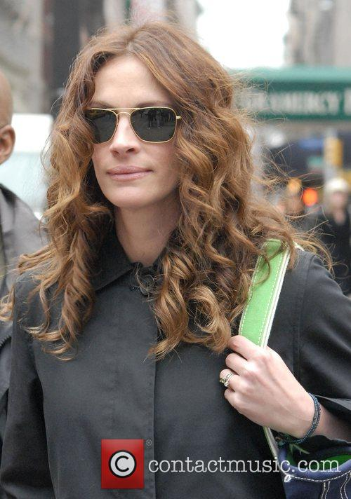 Julia Roberts walks to a reading for her...
