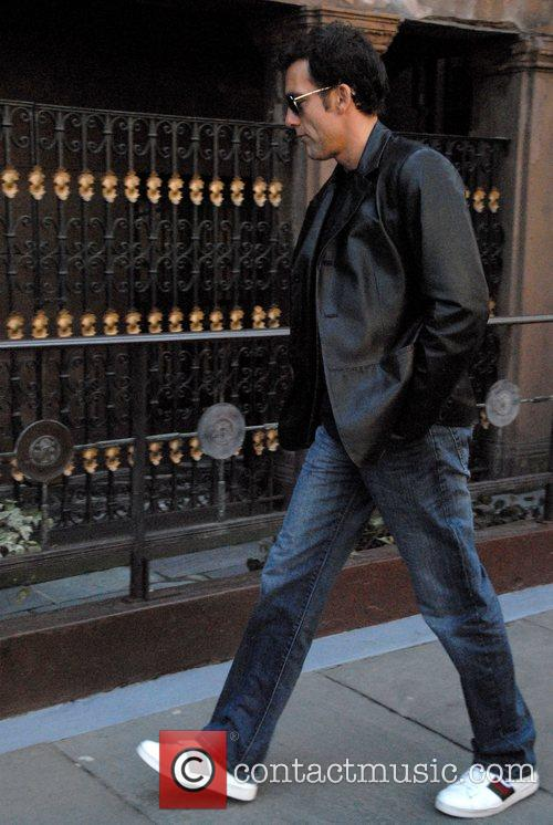 Walking to the set of his new film...