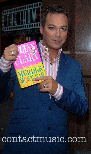 Signs his debut novel 'Murder Most Fab' at...