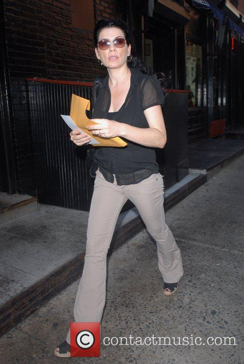Julianna Margulies, 41, strides out in SoHo. The...