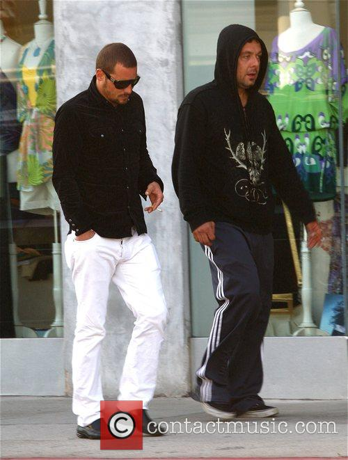Justin Chambers leaving Panini Cafe with a friend
