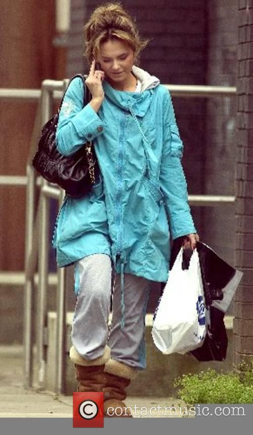 Out shopping dressed in baggy clothes in contrast...