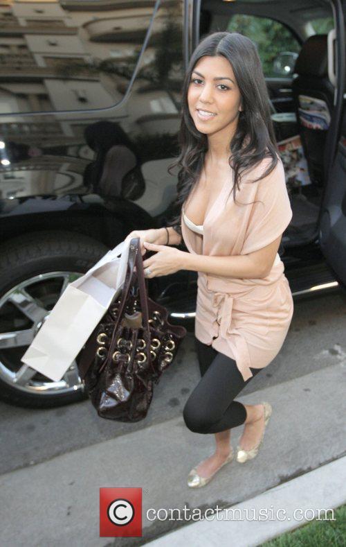 Kourtney Kardashian arrives by limousine to her sisters...