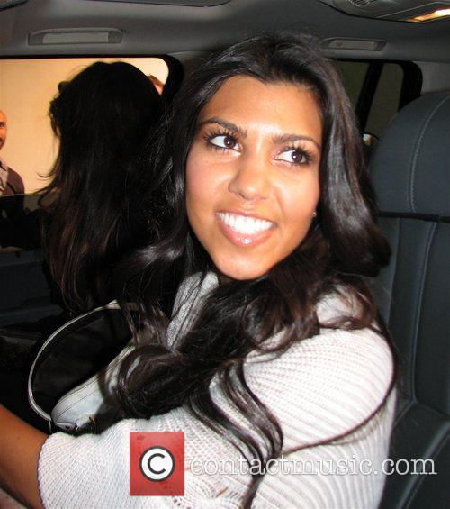 Kourtney Kardashian Arrives home to get ready for...