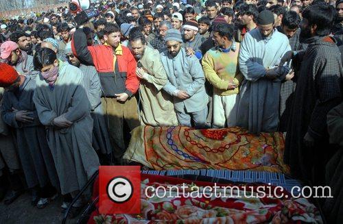 Kashmiri villagers prays during the funeral of Nazir...