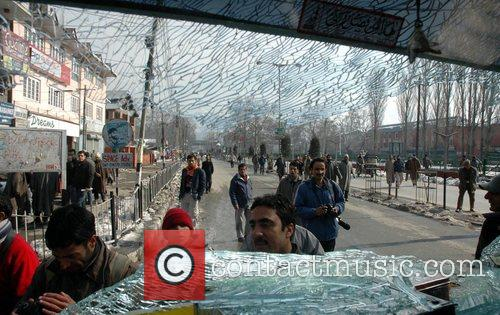 Protesters hurl stones on the private vehicle as...
