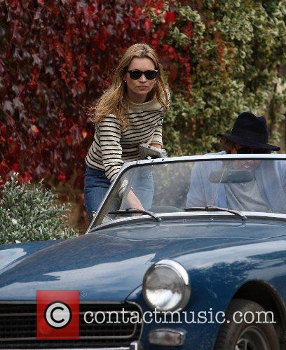 Kate Moss and her daughter Lila with a...
