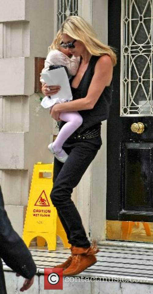 Kate Moss whisked her daughter Lila Grace out...