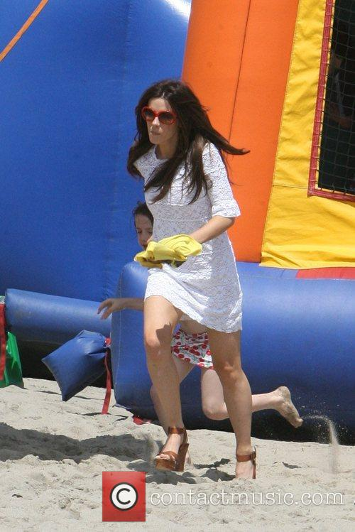 Kate Beckinsale having fun on Malibu beach and...