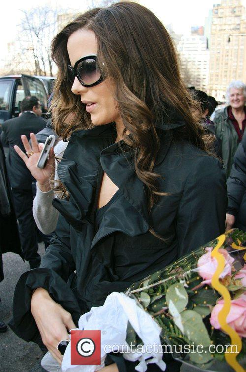 A fan on a wheelchair gives Kate Beckinsale...