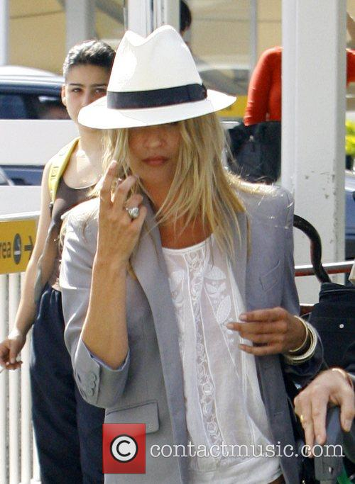 Arrives at Heathrow airport after leaving Davinia Taylor's...