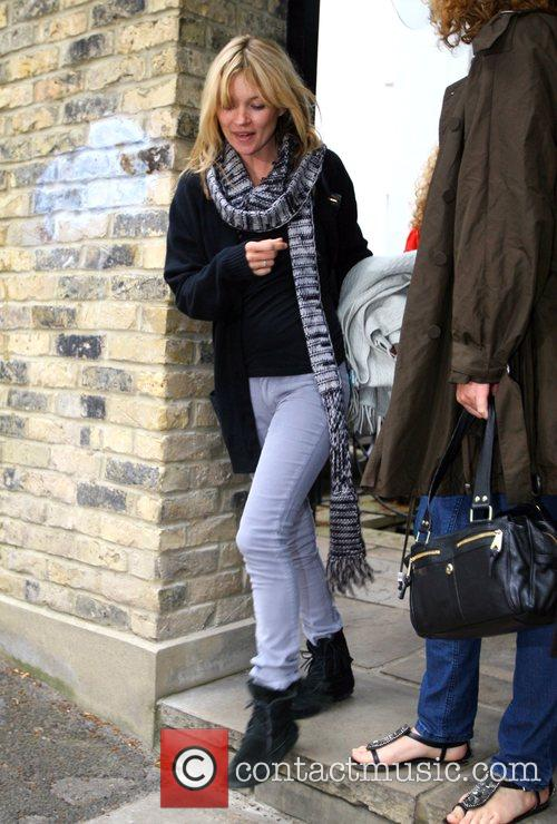 Kate Moss leaving her house and heads off...