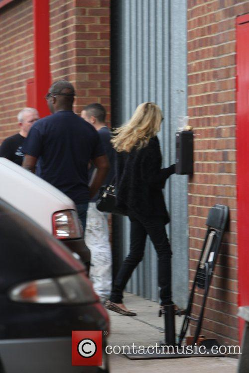 Kate Moss leaves Davinia Taylors house looking unusually...