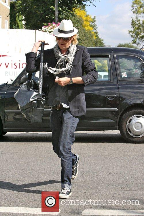 Rhys Ifans arriving at Davinia Taylors house this...