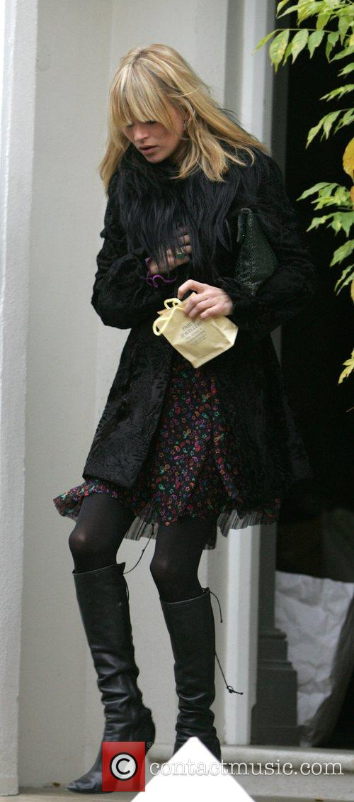 Kate Moss leaving Davinia Taylor's house carrying a...