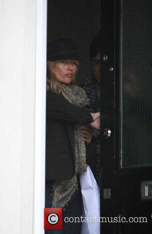 Kate Moss arrives at her new house with...