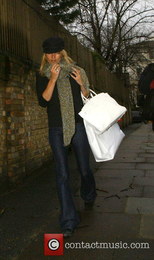 Kate Moss arrives at her new house carrying...
