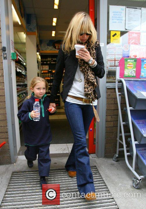 Kate Moss  leaves a newsagent after picking...