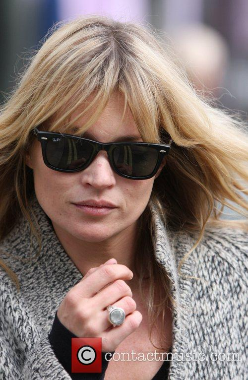 Kate Moss  leaves home in her black...