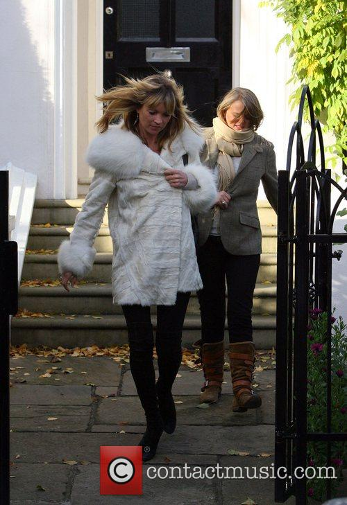 Kate Moss leaves her house to go to...