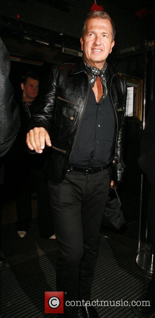 Mario Testino leaving Punk nightclub after celebrating at...