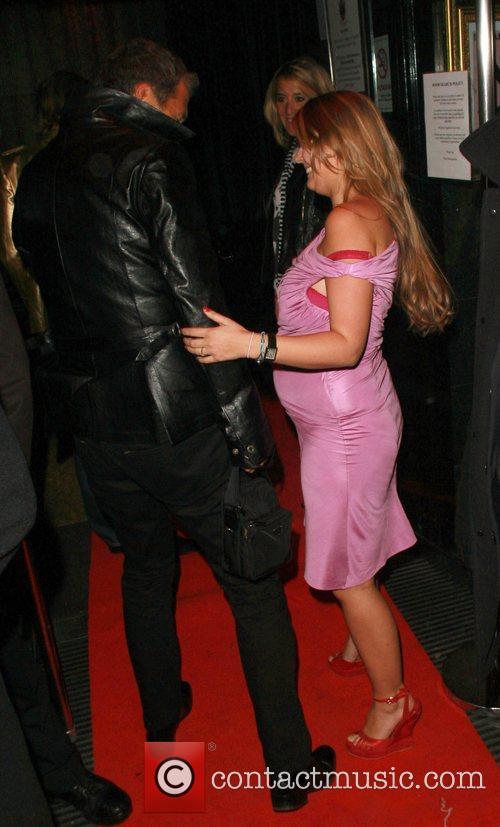 Mario Testino talking to Kate Moss' PA Fiona...