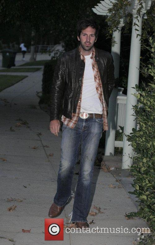 Arriving to have dinner with his wife Katherine...