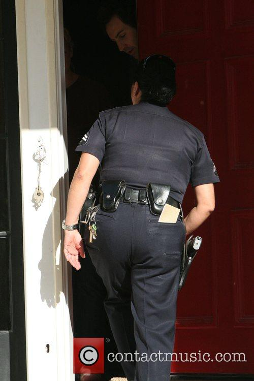 A police officer entering the home of Katherine...