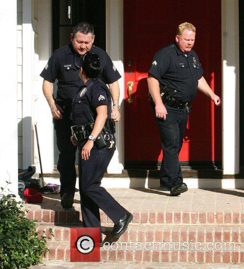 Police officers leaving the home of Katherine Heigl...