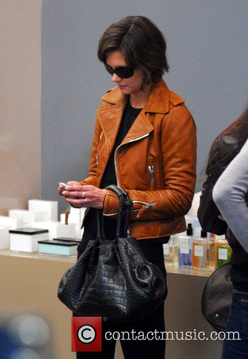 Katie Holmes checking her Blackberry while shopping at...