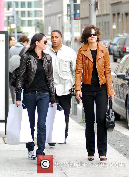 Katie Holmes with a friend and a bodyguard...