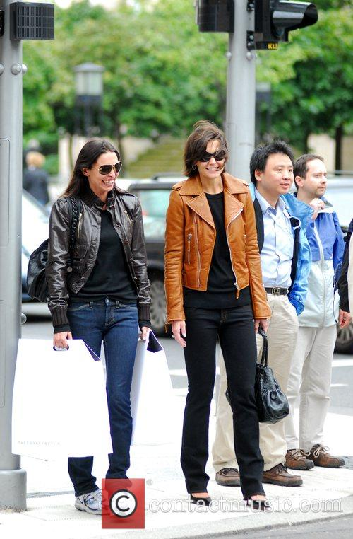 Katie Holmes with a friend after shopping at...