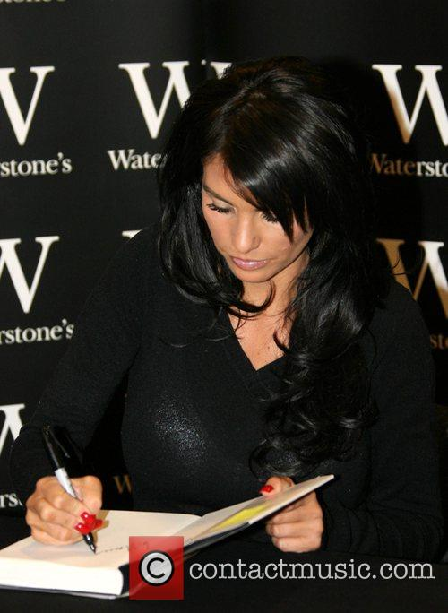 Katie Price aka Jordan signs copies of her...