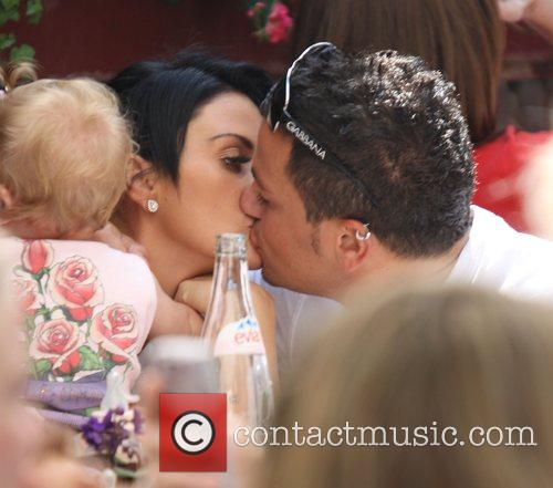 Katie Price with Peter Andre and their daughter...