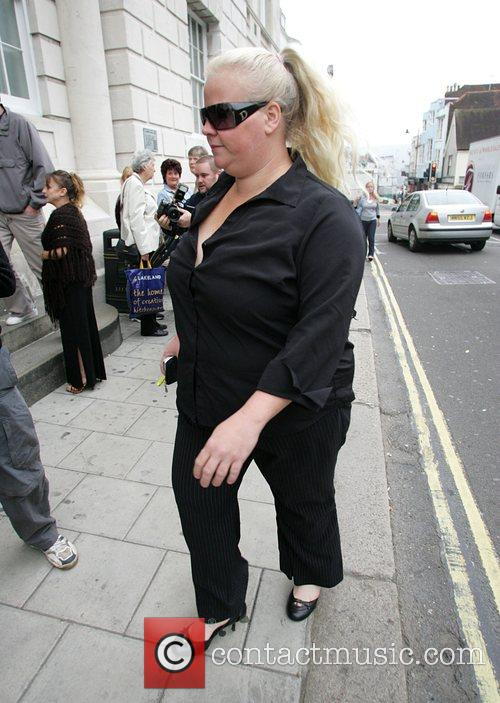 Arriving at court where she is to face...
