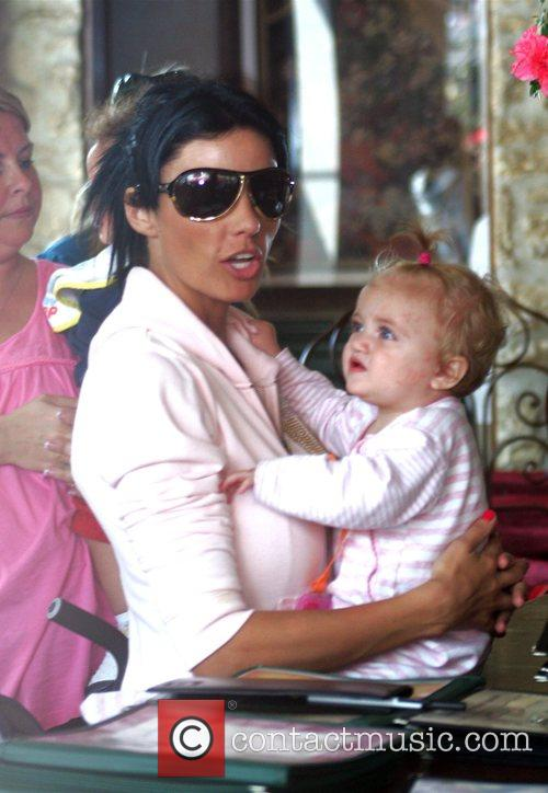 Katie Price with her daughter Princess Tiaamii at...